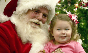 Santa with child at the santa claus christmas store s300