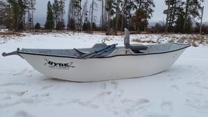 Drift boat in snow s300