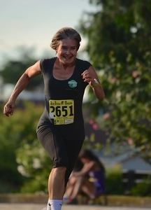 Sue crosses the finish line at the shuffle s300