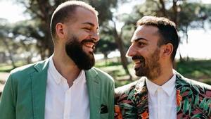 Gay couple smiling standing s300