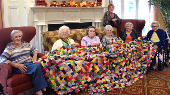 Quilters with quilt cropped s550