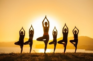 Group children are engaged yoga with trainer ocean 110955 452 s300